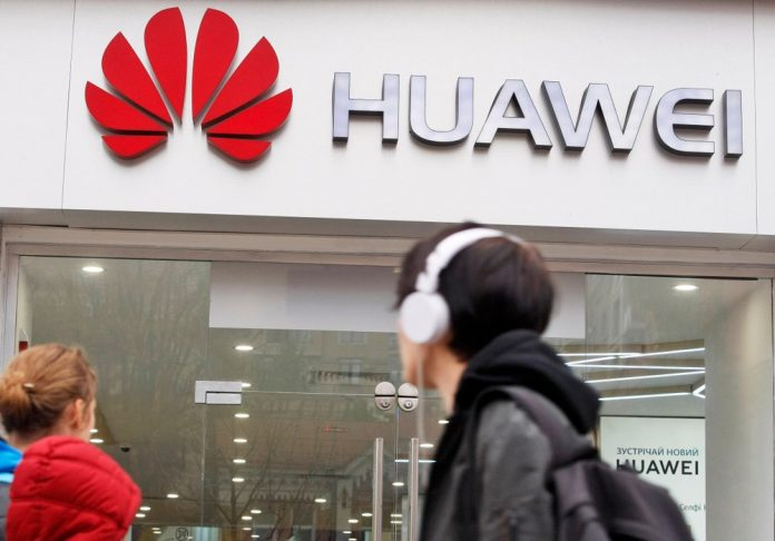 After Huawei blow, China says U.S. must show sincerity for talks